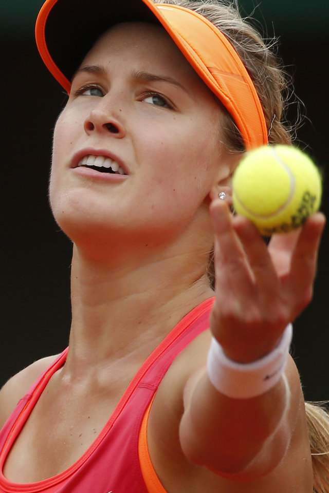 Photo - Canada's Eugenie Bouchard serves the ball during the fourth round match of the French Open tennis tournament against Germany's Angelique Kerber at the Roland Garros stadium, in Paris, France, Sunday, June 1, 2014.  (AP Photo/Michel Euler)