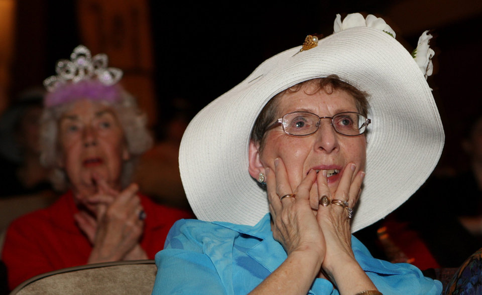 Photo - Cathy Plant, left, and Marg Cashmore react as they watch the  royal wedding, at the Palace Theatre in London, Ontario, early Friday, April 29, 2011.  (AP Photo/The Canadian Press, Dave Chidley) ORG XMIT: DJC108
