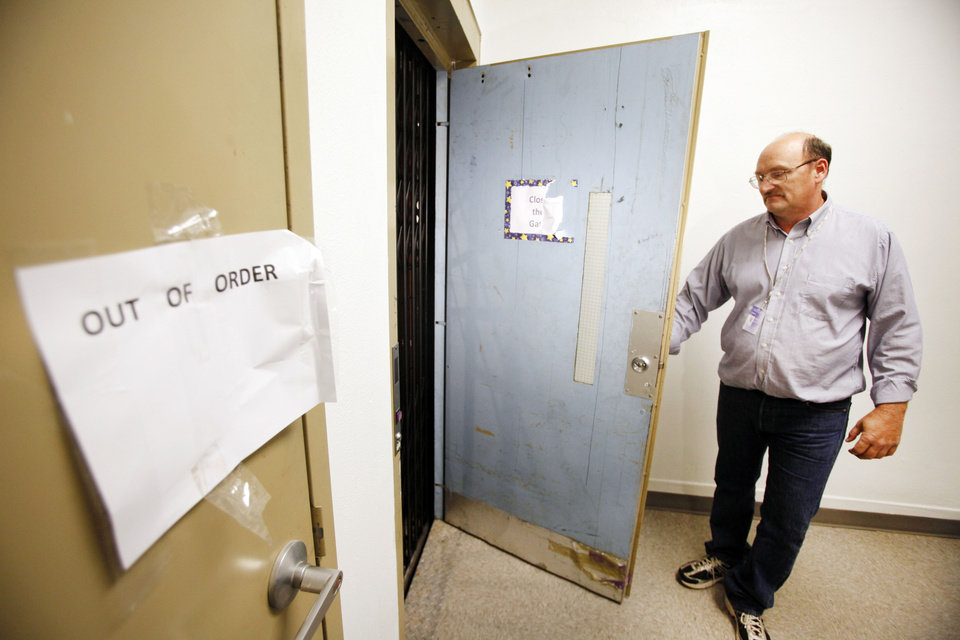 Photo - Dan Bridgfourth, Oklahoma City Public Schools Safety and Security Director shows the elevator where three girls were trapped at Classen School of Advanced Studies in Oklahoma City , Tuesday  Nov. 15,  2011. Photo by Steve Gooch  Steve Gooch