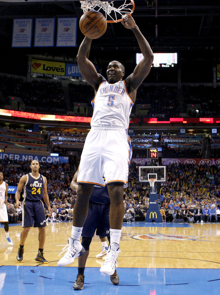 Photo - Oklahoma City's Kendrick Perkins (5) dunks the ball during the NBA game between the Oklahoma City Thunder and the Utah Jazz at the Chesapeake Energy Arena, Sunday, Nov. 24, 2013. Photo by Sarah Phipps, The Oklahoman