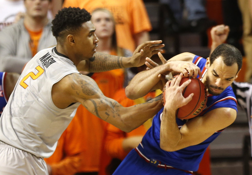 Photo - Oklahoma State's Le'Bryan Nash (2) and Kansas' Perry Ellis (34) fight for a rebound during the men's college basketball game between Oklahoma State University and the University of Kansas at Gallagher-Iba Arena in Stillwater, Okla.,  Saturday, Feb. 7, 2015. OSU won 67-62. Photo by Sarah Phipps, The Oklahoman