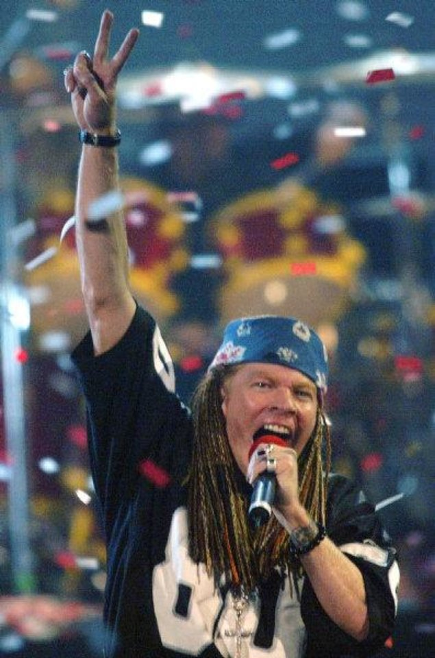 Axl Rose, lead singer for the band Guns N\' Roses, performs during the MTV Video Music Awards at New York\'s Radio City Music Hall on Aug. 29, 2002. (AP Photo/ Beth Keiser)