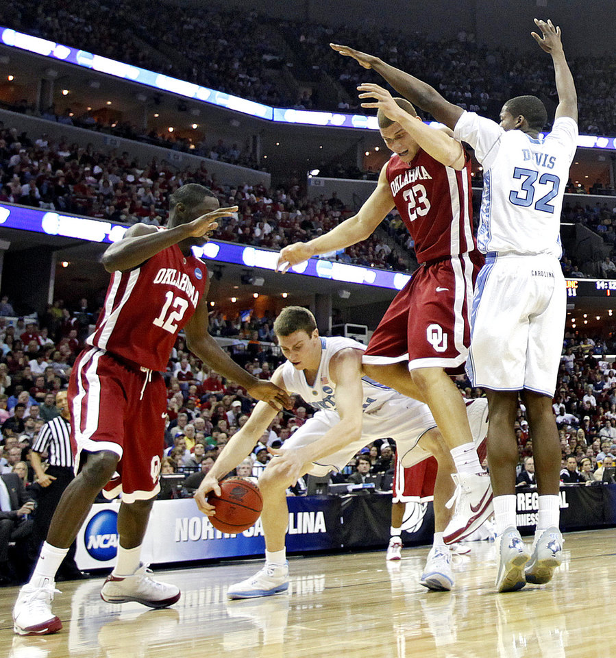Photo - North Carolina's Tyler Hansbrough (50) steals the ball from Oklahoma's Blake Griffin (23) during the first half in the Elite Eight game of NCAA Men's Basketball Regional between the University of North Carolina and the University of Oklahoma at the FedEx Forum on Sunday, March 29, 2009, in Memphis, Tenn.