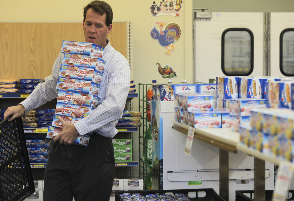 In this photo taken Friday, Nov. 16, 2012, Scott Hubbard of Chico, Calif., loads up on Hostess Zingers at the Hostess store in Redding, Calif., shortly after it was announced Hostess was going out of business. Hubbard said he was going to use them as an office fundraiser going to an organization to help buy Christmas gifts for troops. (AP Photo/Record Searchlight, Andreas Fuhrmann)