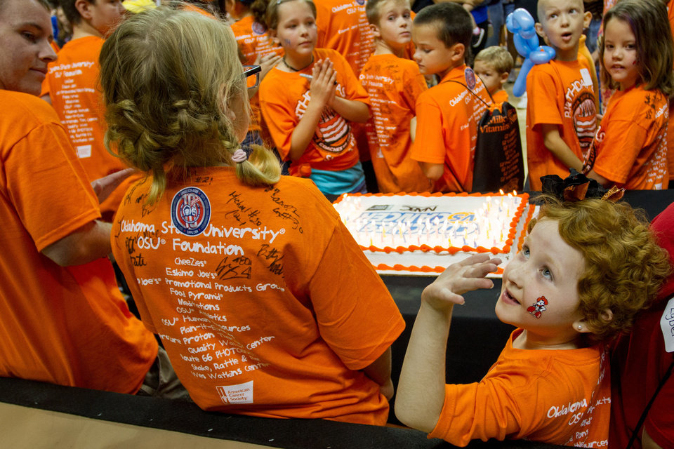 Taylor Brandt waves after her name is announced. Oklahoma State University hosted a Coaches vs. Cancer Birthday party in Gallagher-Iba arena in Stillwater, Ok on Sept. 16, 2012. PHOTO BY MITCHELL ALCALA, For The Oklahoman <strong>Mitchell Alcala</strong>