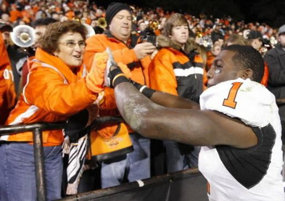 Photo - OSU's Dez  Bryant greets fans after the college football game between Oklahoma State University and University of Colorado at Folsom Field in Boulder, Colo., Saturday, Nov. 15, 2008. OSU won, 30-17. BY NATE BILLINGS, THE OKLAHOMAN