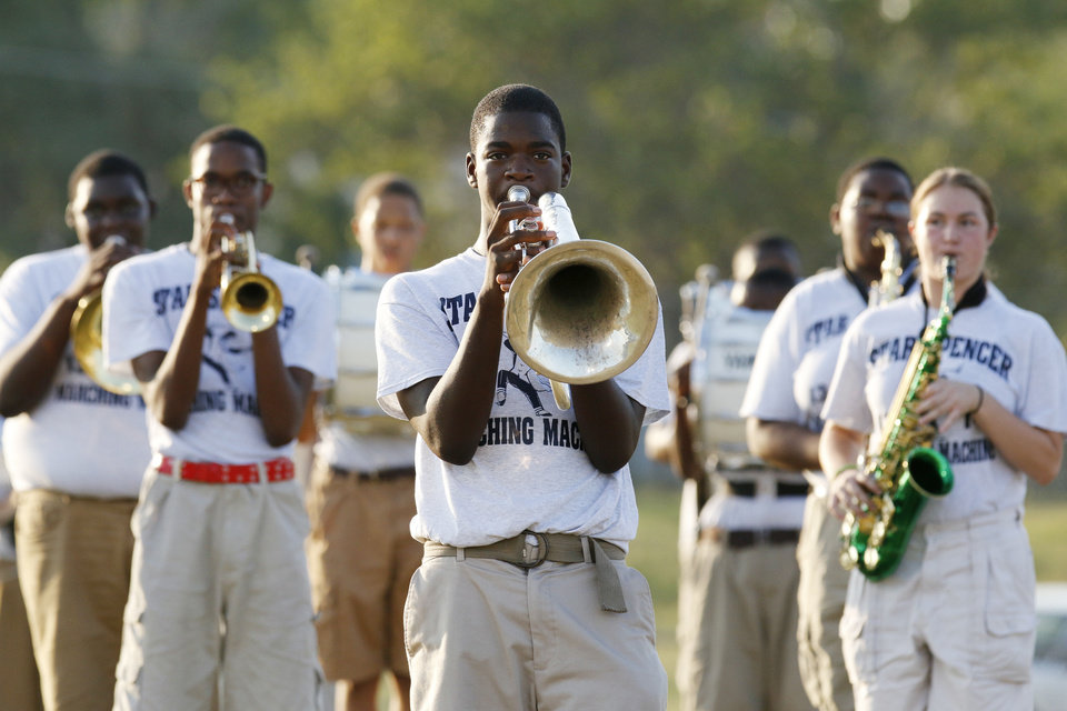 Photo - Rakeem McCray Plays during the pregame. The Star Spencer band performs during the pregame at the high school football game between Millwood and Star Spencer in Spencer, Thursday, September 5, 2013. Photo by Doug Hoke, The Oklahoman