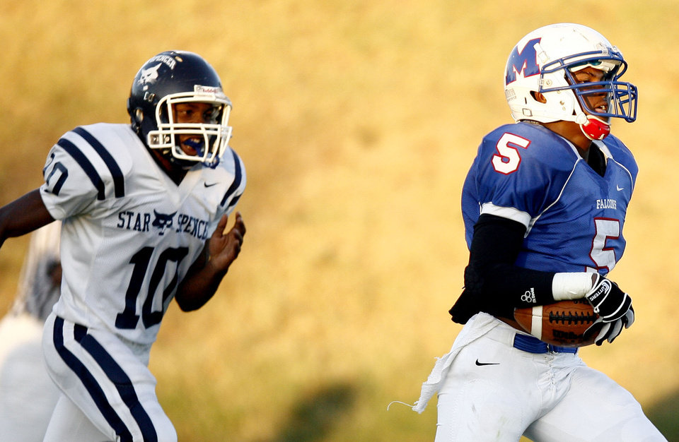 Photo - Millwood's Shevin Patton scores a touchdown as Star Spencer's Carlos Hutson chases him down during the high school football game between Millwood and Star Spencer, Friday, Sept. 3, 2010, at Millwood High School in Oklahoma City. Photo by Sarah Phipps, The Oklahoman