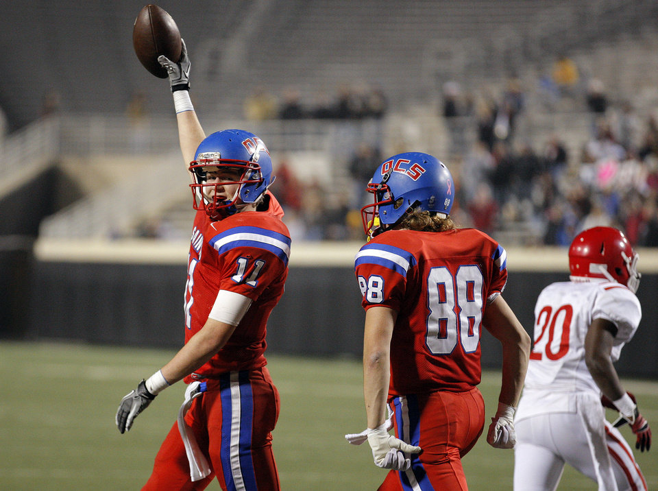 OCS' Garrett Kilborn, (11)  and Jared Goff (88) celebrate a fumble recovery during the Class 2A high school football championships between Davis and Oklahoma Christian School at Boone Pickens Stadium in Stillwater, Okla.,  Saturday,Dec. 8, 2012. Photo by Sarah Phipps, The Oklahoman
