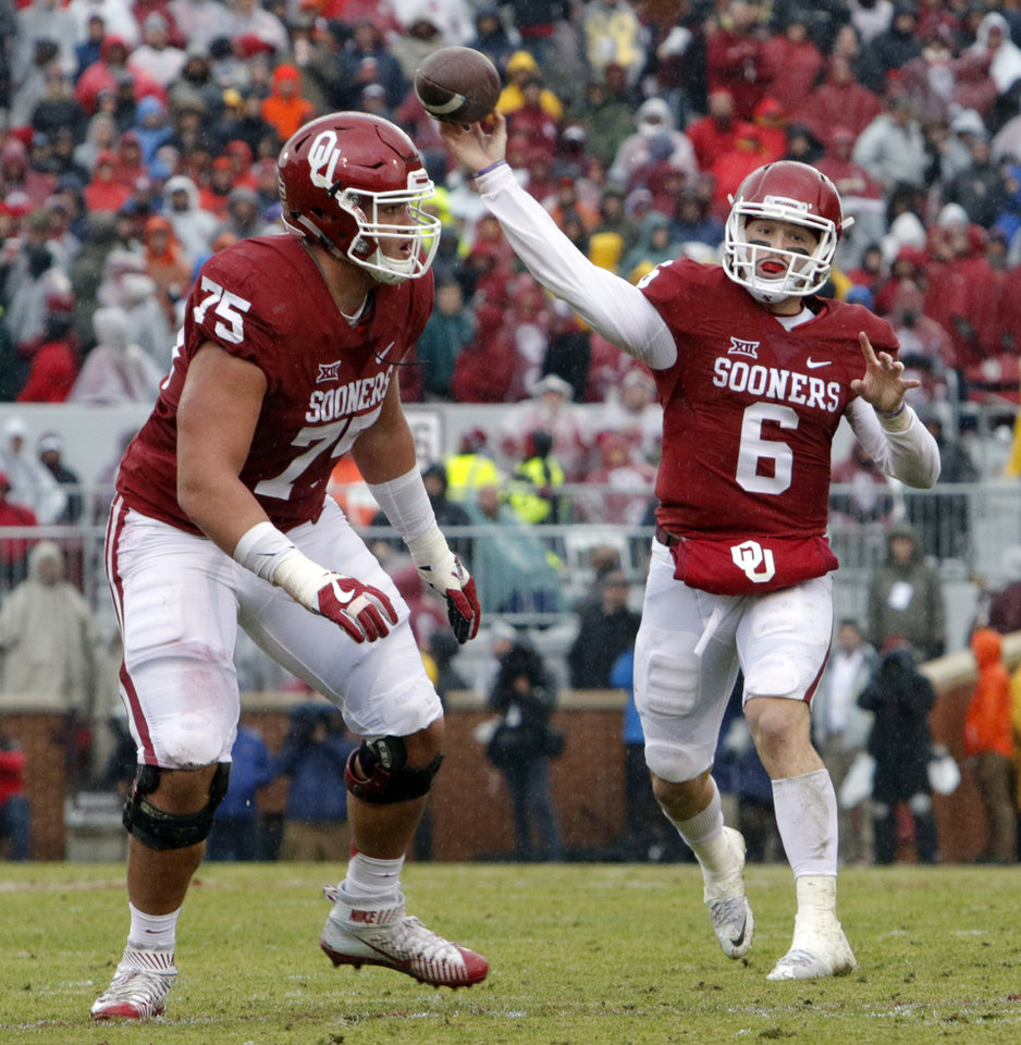 Photo - Oklahoma's Baker Mayfield (6) throws a touchdown pass to Joe Mixon (25) during the Bedlam college football game between the Oklahoma Sooners (OU) and the Oklahoma State Cowboys (OSU) at Gaylord Family - Oklahoma Memorial Stadium in Norman, Okla., Saturday, Dec. 3, 2016. Photo by Steve Sisney, The Oklahoman