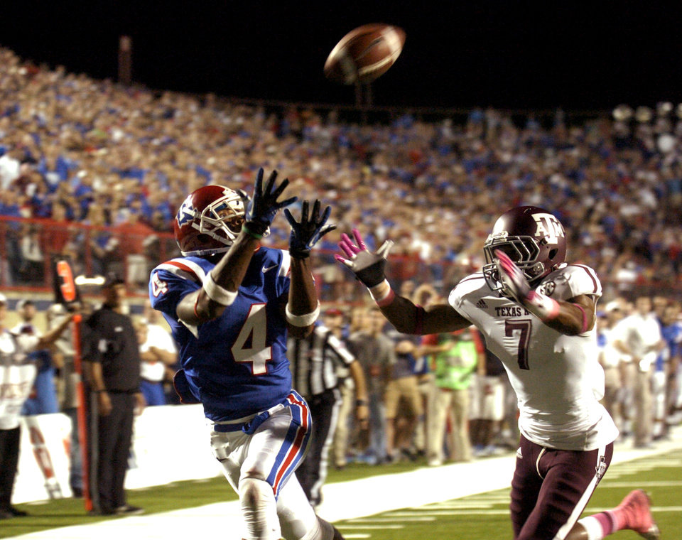 Louisiana Tech's Quinton Patton, left, catches a pass for a touchdown during an NCAA college football game against Texas A&M in Shreveport, La., Saturday, Oct. 13, 2012. (AP Photo/Kita K Wright)