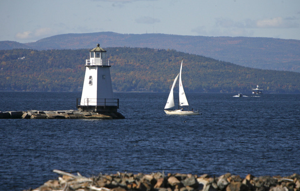 Photo -   FILE-In this Oct. 10, 2008, file photo, boats travel across the waters of Lake Champlain in Burlington, Vt. Mountain and lake views along with fall foliage can be had for free in Vermont's largest city of Burlington, which feels more like a big town than a city. (AP Photo/Toby Talbot)
