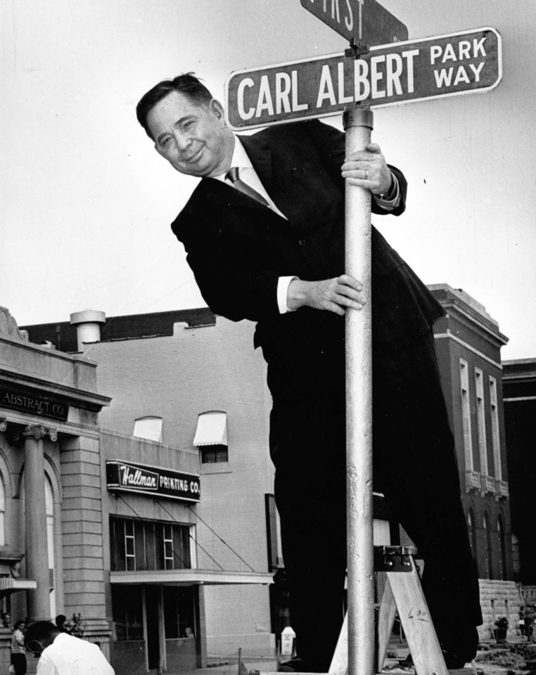 Photo - A street name change in Mc Alester brings a smile to U.S. Rep. Carl Albert in 1964.    OKLAHOMAN ARCHIVES - THE OKLAHOMAN ARCHIVES