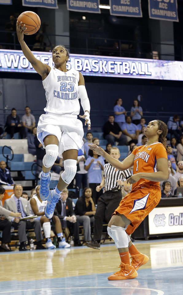Photo - North Carolina's Diamond DeShields (23) drives to the basket as Clemson's Charmaine Tay (1) defends during the second half of an NCAA college basketball game in Chapel Hill, N.C., Thursday, Jan. 16, 2014. North Carolina won 78-55. (AP Photo/Gerry Broome)