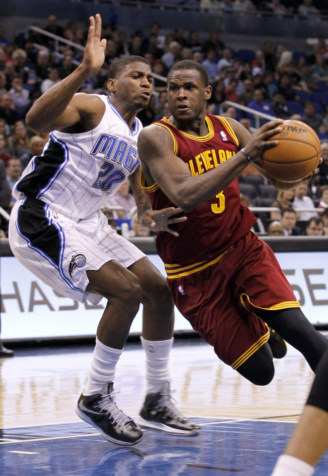Cleveland Cavaliers guard Dion Waiters (3) drives to the net past Orlando Magic forward DeQuan Jones (20) during the first half of an NBA basketball game against the Orlando Magic in Orlando, Fla., on Saturday, Feb. 23, 2013. (AP Photo/Reinhold Matay)