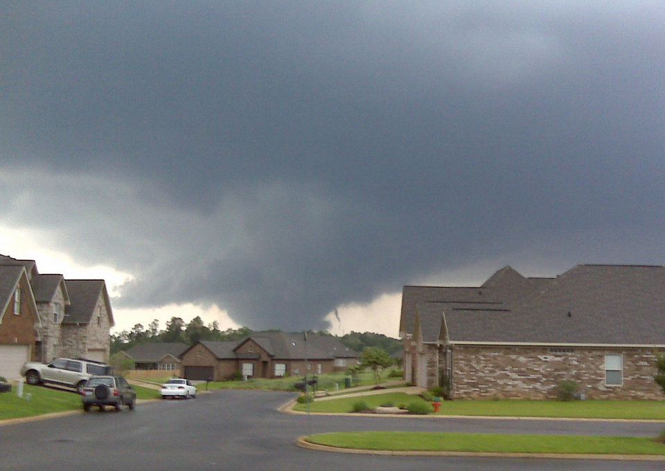 Photo - A funnel cloud approaches Tuscaloosa, Ala. where reported wide spread damage has occurred from the storm in this photo taken looking north from Taylorsville, Ala. Wednesday April 27, 2011.  (AP Photo/The Birmingham News, Don Kausler, Jr.)