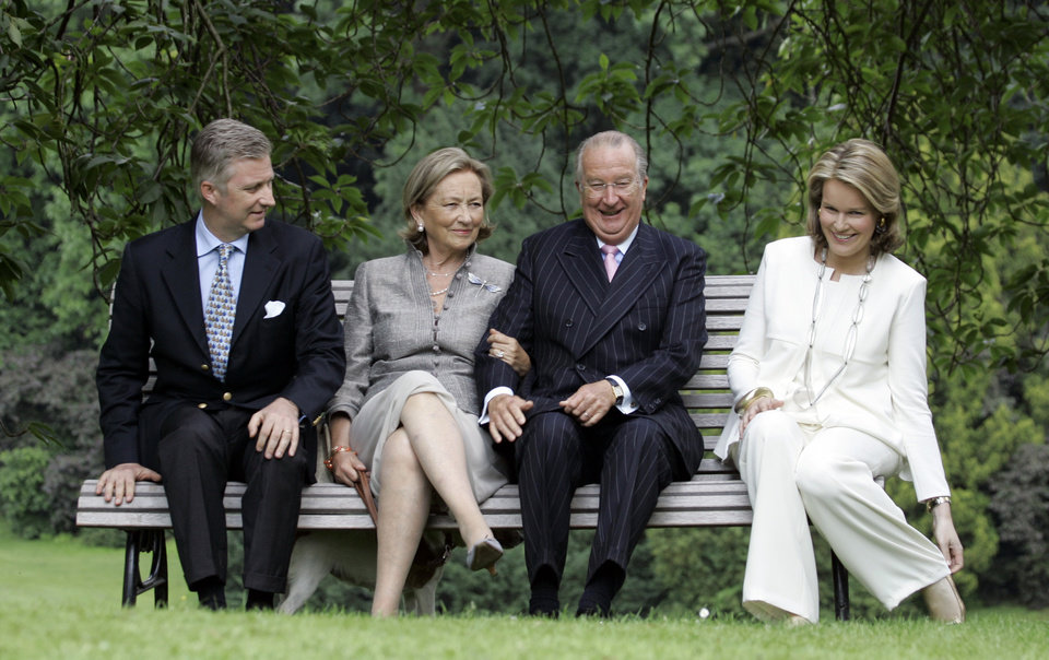 File - In this June 17, 2008 file photo, from left to right, Belgium's Crown Prince Philippe, Queen Paola, King Albert II and Belgium's Princess Mathilde sit during an official photo session at the Royal Palace in Laeken, Belgium. Albert II�s kingdom is increasingly threatened by royal-bashing separatists seeking the breakup of Belgium. Now, a book dipping deep into the privacy of kings and princes is adding insult to injury. With its back against the wall, the royal palace sought to strike back in the week of Oct. 29, 2012, seeking action against the journalist who published the book ��Royal Questions�� which is sometimes as rich on dangerous liaisons as it is on the use of anonymous sources. (AP Photo/Virginia Mayo, File)