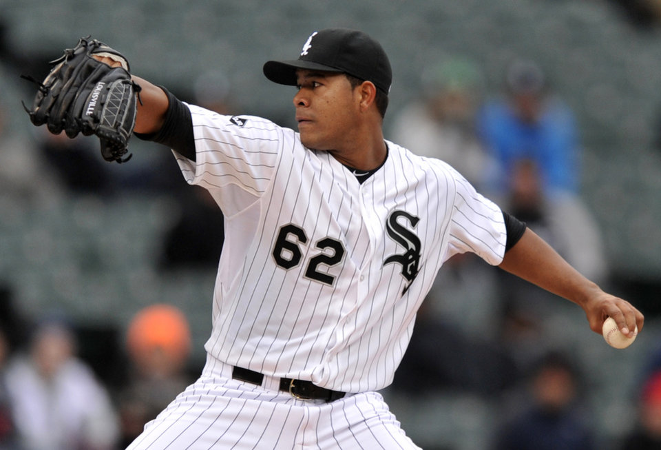 Photo - Chicago White Sox starter Jose Quintana delivers a pitch during the first inning of a  baseball game against the Minnesota Twins in Chicago, Thursday, April 3, 2014. (AP Photo/Paul Beaty)