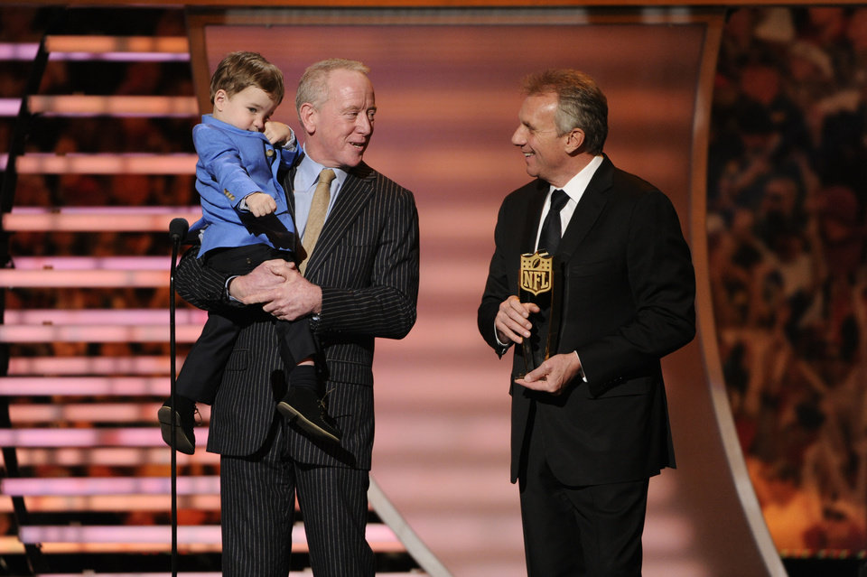 Photo - Former NFL player Joe Montana, right, presents the award for AP Most Valuable Player to Archie Manning, who holds his grandson Marshall Manning, at the third annual NFL Honors at Radio City Music Hall on Saturday, Feb. 1, 2014, in New York. Archie Manning accepted on behalf of his son Peyton. (Photo by Evan Agostini/Invision for NFL/AP Images)