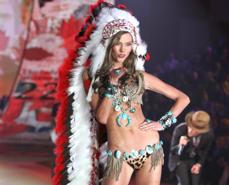 This Nov. 7, 2012 photo released by Starpix shows model Karlie Kloss wearing an Indian headdress during the taping of The 2012 Victoria's Secret Fashion Show in New York. Victoria Secret has apologized for putting a replica of a Native American headdress on a model for its annual fashion show. The company responded to criticism over the weekend by saying it was sorry to have upset anyone and would not include the outfit in the show's television broadcast next month. (AP Photo/Starpix, Amanda Schwab)