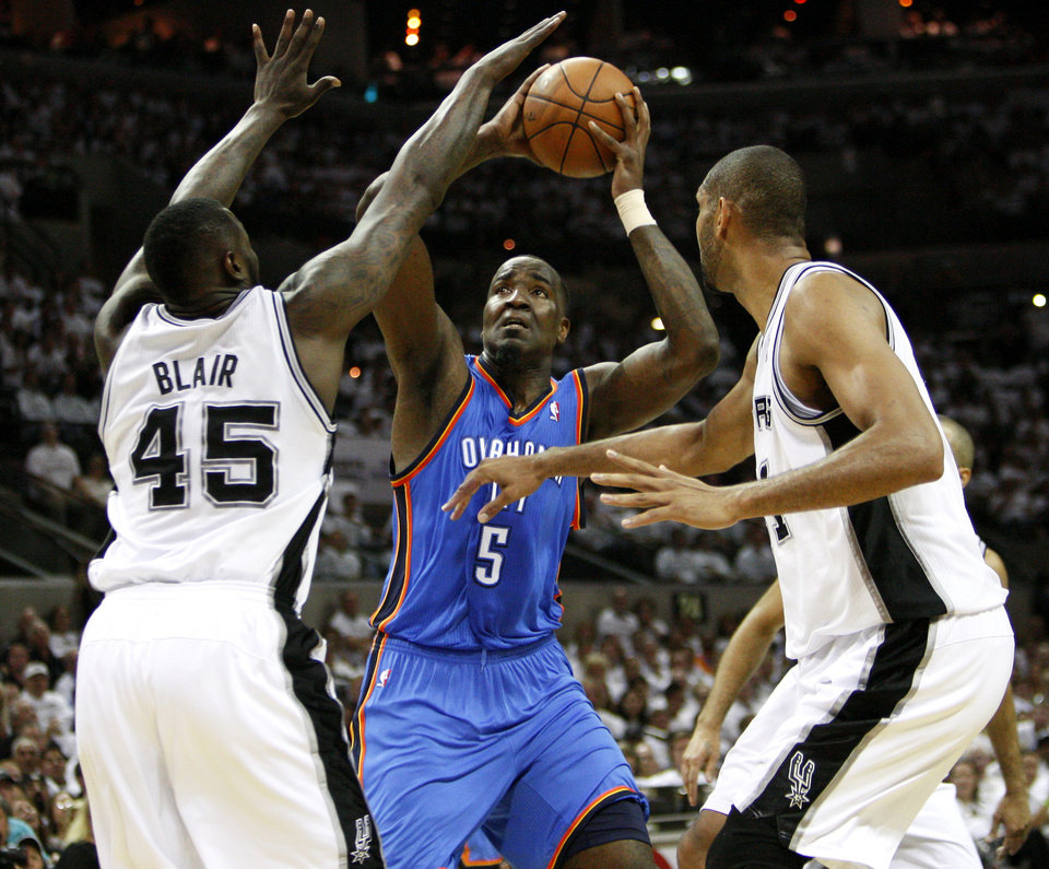 Photo - Oklahoma City's Kendrick Perkins (5) shoots the ball between San Antonio's DeJuan Blair (45) and Tim Duncan (21) during Game 5 of the Western Conference Finals between the Oklahoma City Thunder and the San Antonio Spurs in the NBA basketball playoffs at the AT&T Center in San Antonio, Monday, June 4, 2012. Photo by Nate Billings, The Oklahoman