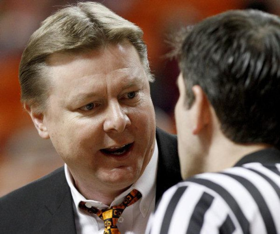 OSU coach Kurt Budke argues with an official during a timeout in the Big 12 women's college basketball game between Oklahoma State University and Texas A&M at Gallagher-Iba Arena in Stillwater, Okla., on Wednesday, Jan. 12, 2011.  Photo by Bryan Terry, The Oklahoman ORG XMIT: KOD