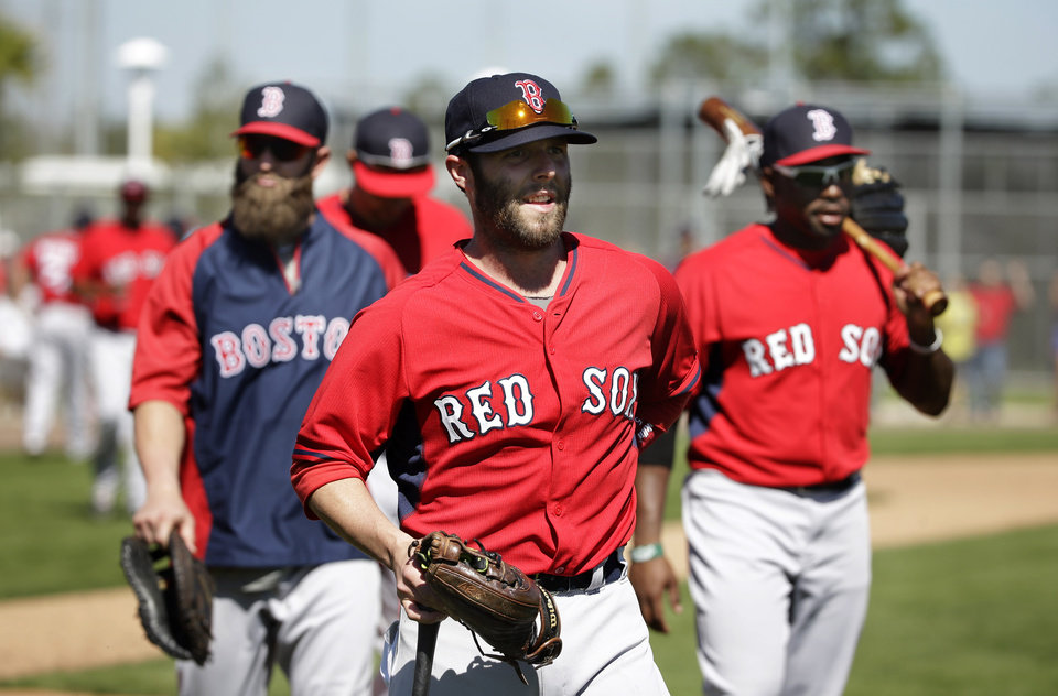 Photo - Boston Red Sox second baseman Dustin Pedroia, front, first baseman Mike Napoli, left, and center fielder Jackie Bradley Jr., right, step off the field during spring training baseball practice Tuesday, Feb. 18, 2014, in Fort Myers, Fla. (AP Photo/Steven Senne)