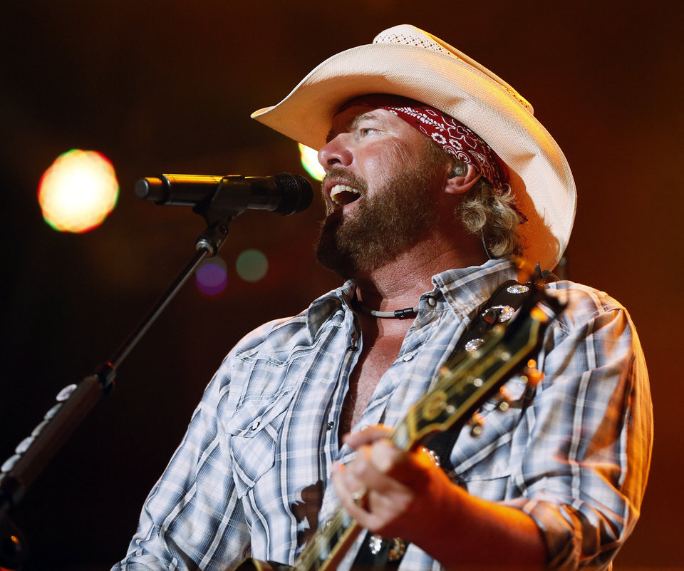 Toby Keith performs during the Oklahoma Twister Relief Concert, benefiting victims of the May tornadoes, at Gaylord Family - Oklahoma Memorial Stadium on the campus of the University of Oklahoma in Norman, Okla., Saturday, July 6, 2013. Photo by Nate Billings, The Oklahoman