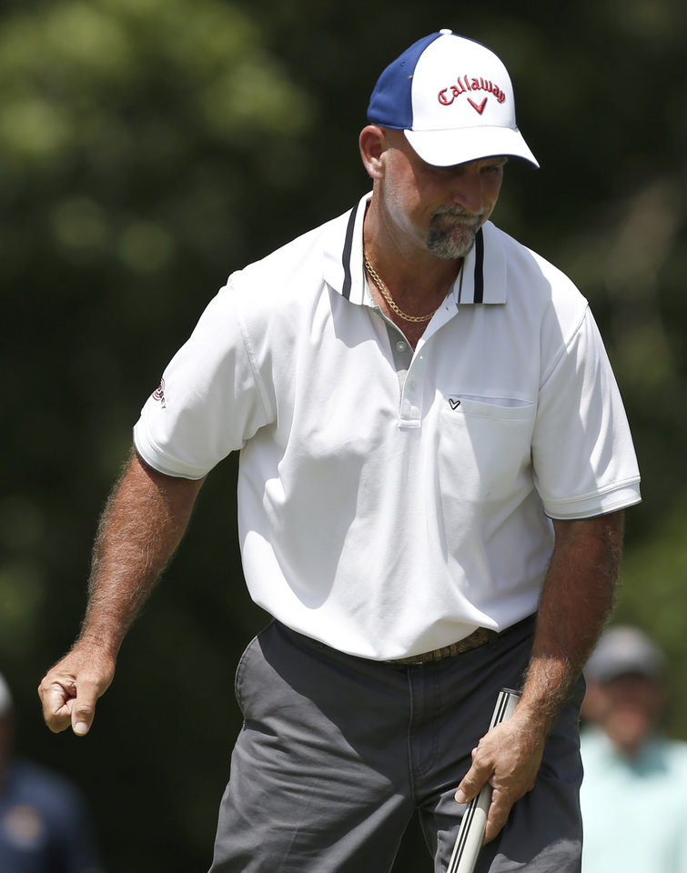 Photo - Marco Dawson reacts after a putt on the 16th hole in the third round of the U.S. Senior Open golf tournament at Oak Tree National in Edmond, Okla., Saturday, July 12, 2014. Photo by Sarah Phipps, The Oklahoman