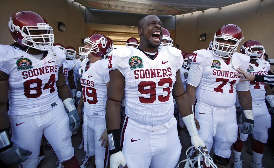 Oklahoma's Gerald McCoy leads the Sooners onto the field during the first half of the Brut Sun Bowl college football game between the University of Oklahoma Sooners (OU) and the Stanford University Cardinal on Thursday, Dec. 31, 2009, in El Paso, Tex.   Photo by Chris Landsberger, The Oklahoman