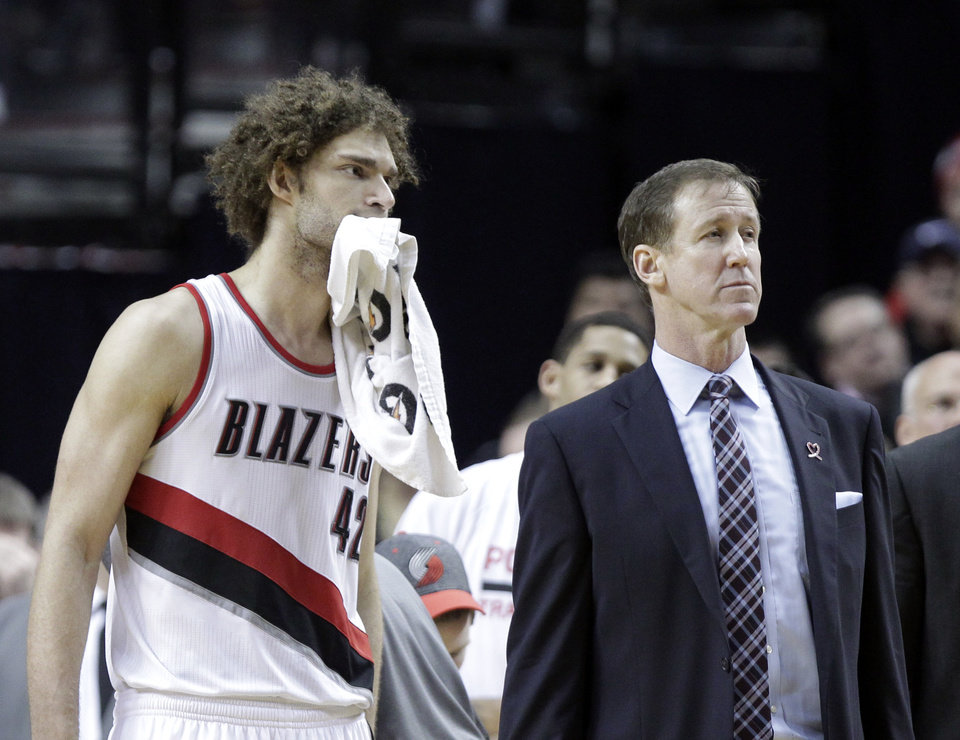 Photo - Portland Trail Blazers center Robin Lopez, left, and coach Terry Stotts watch as they lose the review on an out-of-bounds call late in the second half of an NBA basketball game against the Oklahoma City Thunder in Portland, Ore., Tuesday, Feb. 11, 2014.  The Thunder won 98-95. (AP Photo/Don Ryan)