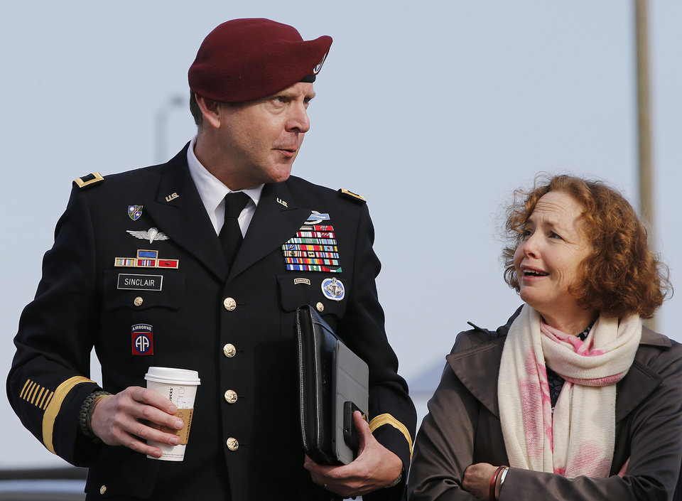 Photo - Brig. Gen. Jeffrey Sinclair, left, who admitted to inappropriate relationships with three subordinates, arrives at the courthouse for sentencing at Fort Bragg, N.C., Thursday, March 20, 2014 with attorney Ellen Brotman.  Sinclair was reprimanded and docked $20,000 in pay Thursday, avoiding jail time in one of the U.S. military's most closely watched courts-martial. (AP Photo/Ellen Ozier)