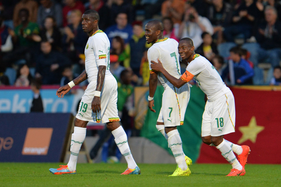 Photo - Cameroon's Mohammadou Idrissou, from left, Landry N'Guemo and Eyong Enow celebrate after scoring during their friendly soccer match against Macedonia in Kufstein, Austrian province of Tyrol, on Monday, May 26, 2014. (AP Photo/Kerstin Joensson)