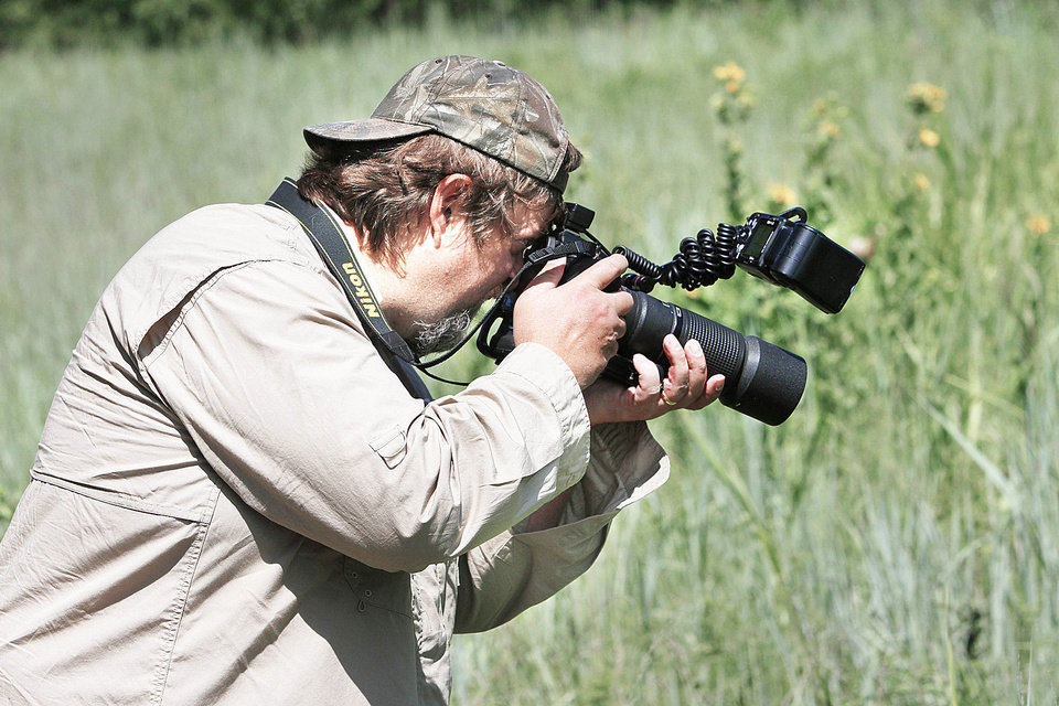 Bryan Reynolds photographs butterflies at the Lexington Wildlife Management Area, Friday July 19, 2013. Photo By Steve Gooch, The Oklahoman