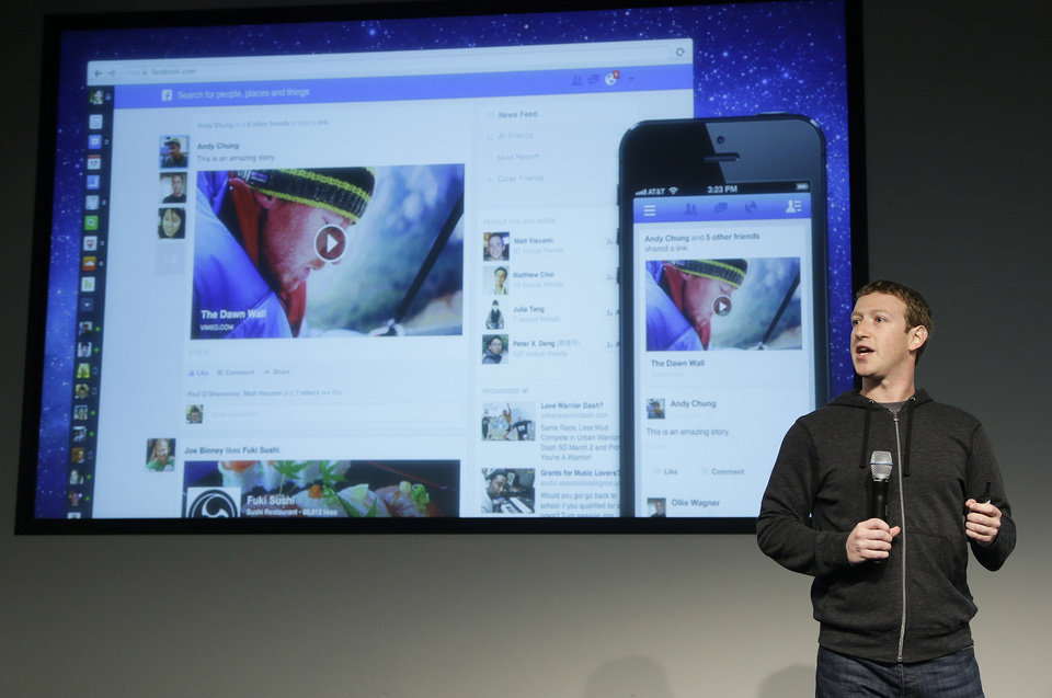 Facebook CEO Mark Zuckerberg speaks at Facebook headquarters in Menlo Park, Calif., Thursday, March 7, 2013. Zuckerberg on Thursday unveiled a new look for the social network\'s News Feed, the place where its 1 billion users congregate to see what\'s happening with their friends, family and favorite businesses.(AP Photo/Jeff Chiu)