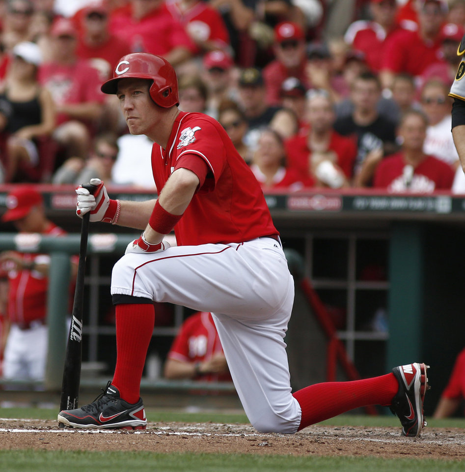 Photo - Cincinnati Reds' Todd Frazier kneels at home plate after striking out with the bases loaded in the fourth inning of a baseball game against the Pittsburgh Pirates, Sunday, July 13, 2014, in Cincinnati. (AP Photo/David Kohl)