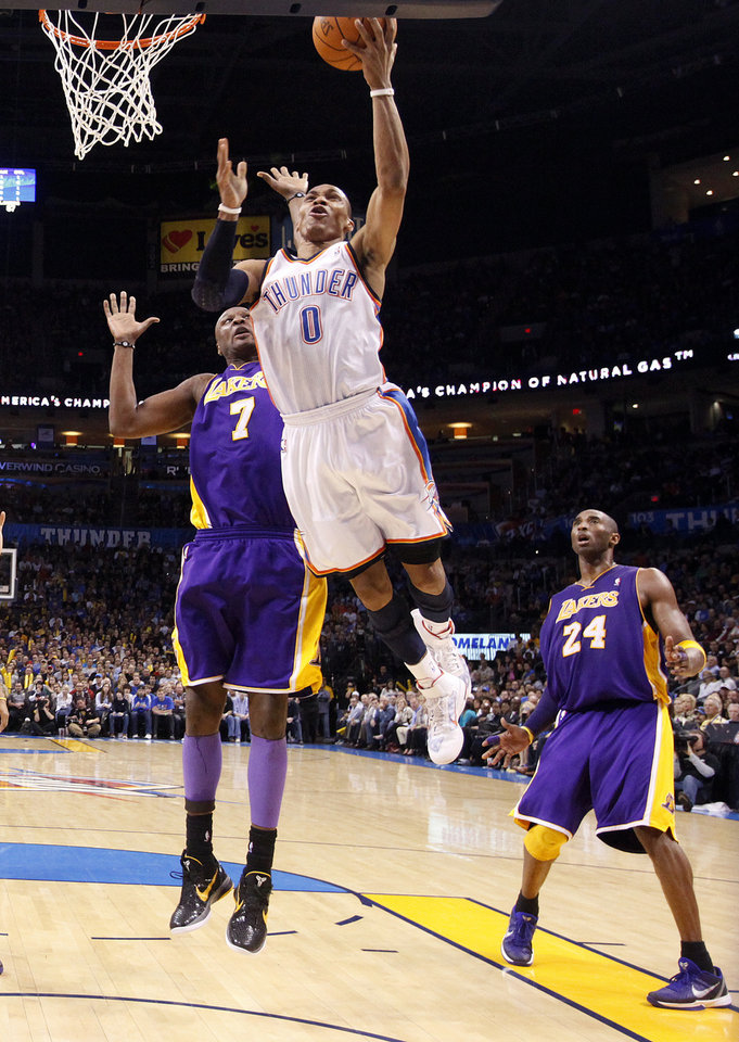 Photo - Oklahoma City's Russell Westbrook (0) shoots as Lakers' Lamar Odom (7) defends during the NBA basketball game between the Oklahoma City Thunder and the Los Angeles Lakers, Sunday, Feb. 27, 2011, at the Oklahoma City Arena.Photo by Sarah Phipps, The Oklahoman