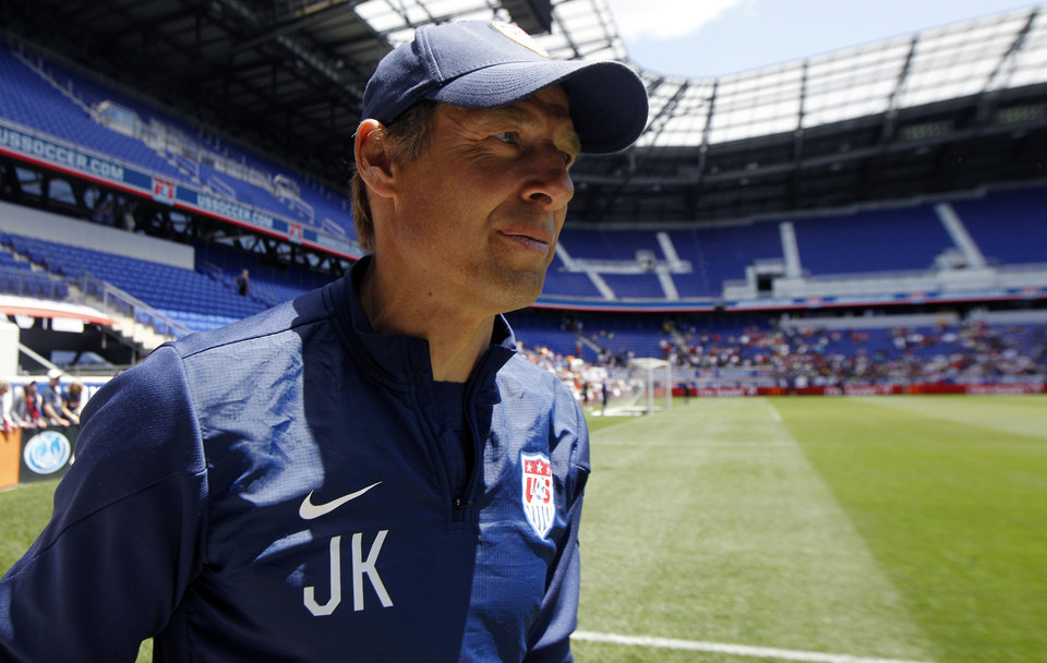 Photo - United States head coach Jurgen Klinsmann walks on the field during an open workout, Saturday, May 31, 2014, in Harrison, N.J. The United States are scheduled to Turkey in an international friendly soccer game on Sunday. (AP Photo/Julio Cortez)