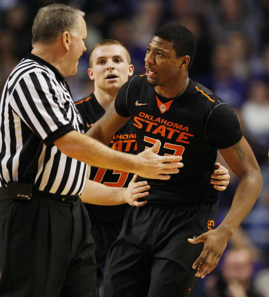 Photo - OSU's Marcus Smart, right, talks with an official after being called for a technical foul during a 74-71 loss to Kansas State on Saturday. AP Photo