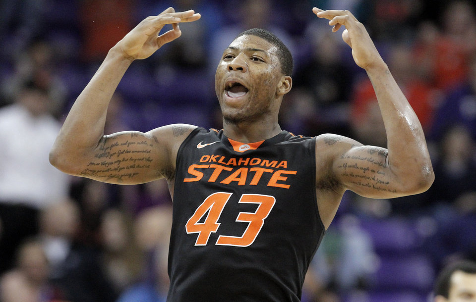 OSU's Marcus Smart celebrates after hitting a 3-pointer during Monday night's matchup against TCU. AP photo