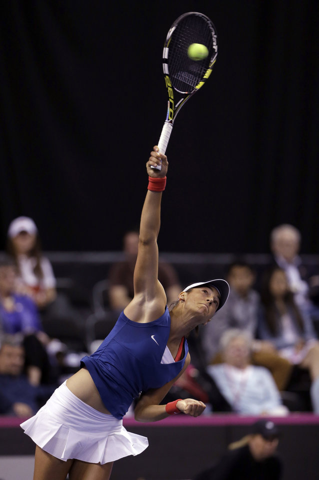 Photo - France's Caroline Garcia serves to United States' Madison Keys during a Fed Cup singles world group playoff tennis match Sunday, April 20, 2014, in St. Louis. Garcia won 6-4, 6-3.(AP Photo/Jeff Roberson)