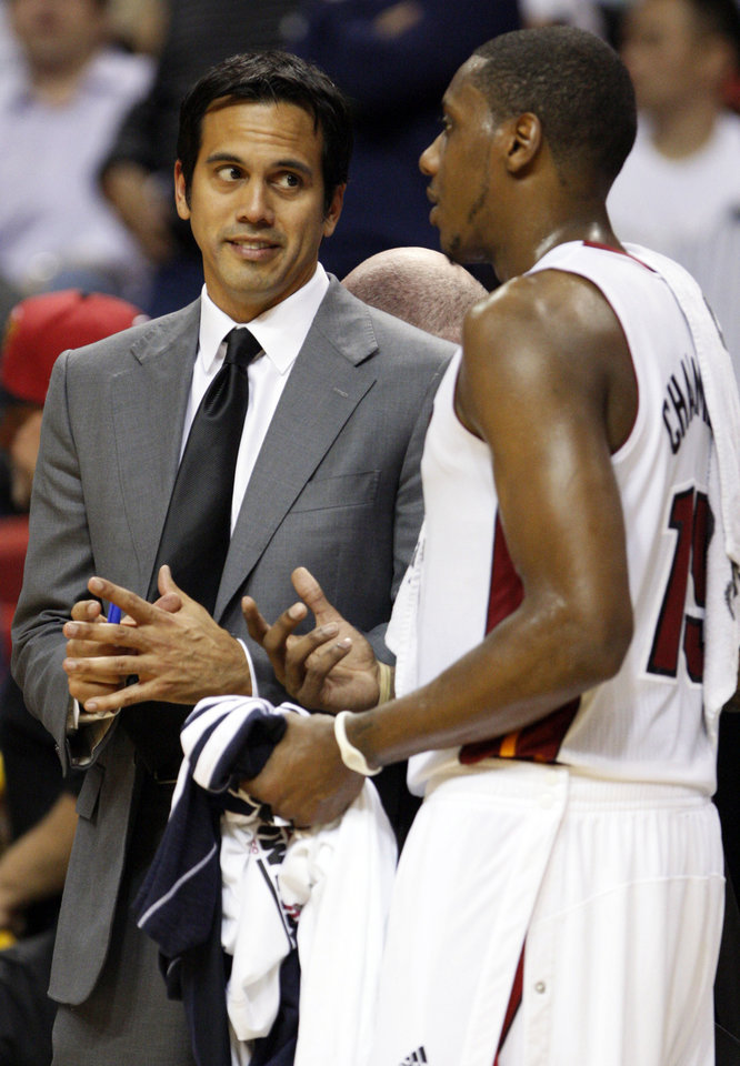 Miami Heat head coach Erik Spoelstra, left, talks with guard Mario Chalmers during the second half of an NBA basketball game against the Brooklyn Nets, Wednesday, Nov. 7, 2012, in Miami. The Heat defeated the Nets 103-73. (AP Photo/Wilfredo Lee)