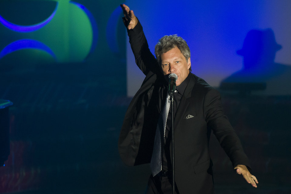 Photo - Jon Bon Jovi performs at the Songwriters Hall of Fame Awards on Thursday, June 12, 2014, in New York. (Photo by Charles Sykes/Invision/AP)