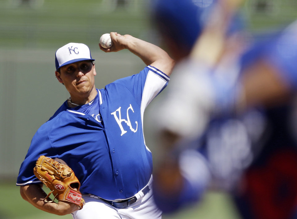 Photo - CORRECTS SPELLING OF SURPRISE - Kansas City Royals starting pitcher Jason Vargas throws to Los Angeles Dodgers' Adrian Gonzalez during the second inning of a spring exhibition baseball game Tuesday, March 11, 2014, in Surprise, Ariz. (AP Photo/Darron Cummings)