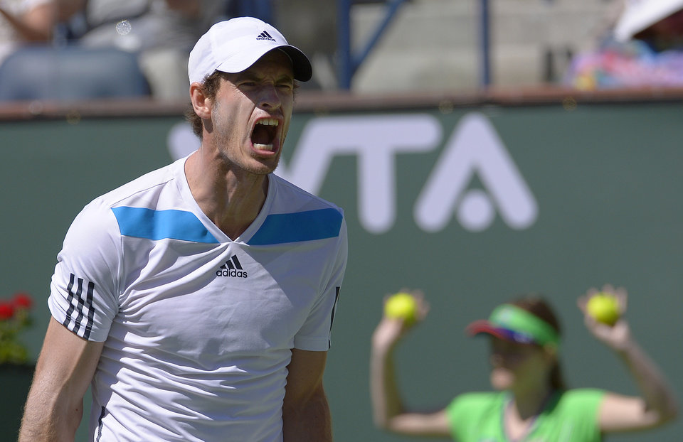 Photo - Andy Murray, of Great Britain, reacts after losing a point against Milos Raonic, of Canada, during  fourth round match at the BNP Paribas Open tennis tournament, Wednesday, March 12, 2014, in Indian Wells, Calif. (AP Photo/Mark J. Terrill)