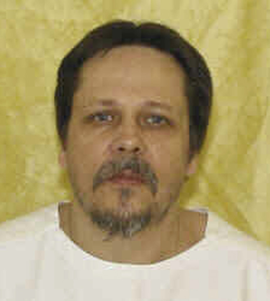 Photo - FILE-In this undated file photo provided by the Ohio Department of Rehabilitation and Correction shows Dennis McGuire. A condemned Ohio killer facing a never-tried lethal injection method has arrived at the state death house a day ahead of his scheduled execution. The Department of Rehabilitation and Correction plans to use a combination of a sedative and a painkiller to put McGuire to death for the 1989 rape and fatal stabbing of Joy Stewart in Preble County in western Ohio. (AP Photo/Ohio Department of Rehabilitation and Correction, File)