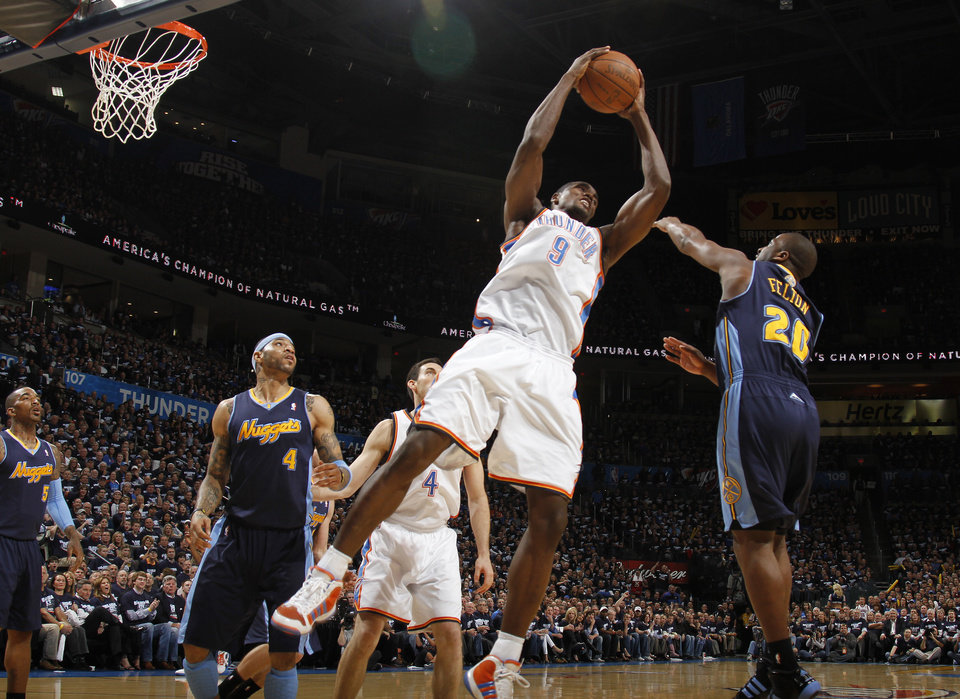 Oklahoma City's Serge Ibaka (9) graba a rebound in front of Denver's Raymond Felton (20) during the NBA basketball game between the Denver Nuggets and the Oklahoma City Thunder in the first round of the NBA playoffs at the Oklahoma City Arena, Wednesday, April 27, 2011. Photo by Bryan Terry, The Oklahoman