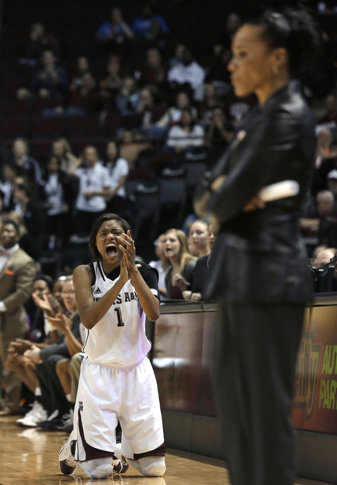 Photo - Texas A&M guard Courtney Williams (1) celebrates a score while South Carolina coach Dawn Staley stands in the foreground during the second half of an NCAA college basketball game, Thursday, Jan. 16, 2014, in College Station, Texas. Texas A&M defeated South Carolina 67-65 in overtime.  (AP Photo/Patric Schneider)
