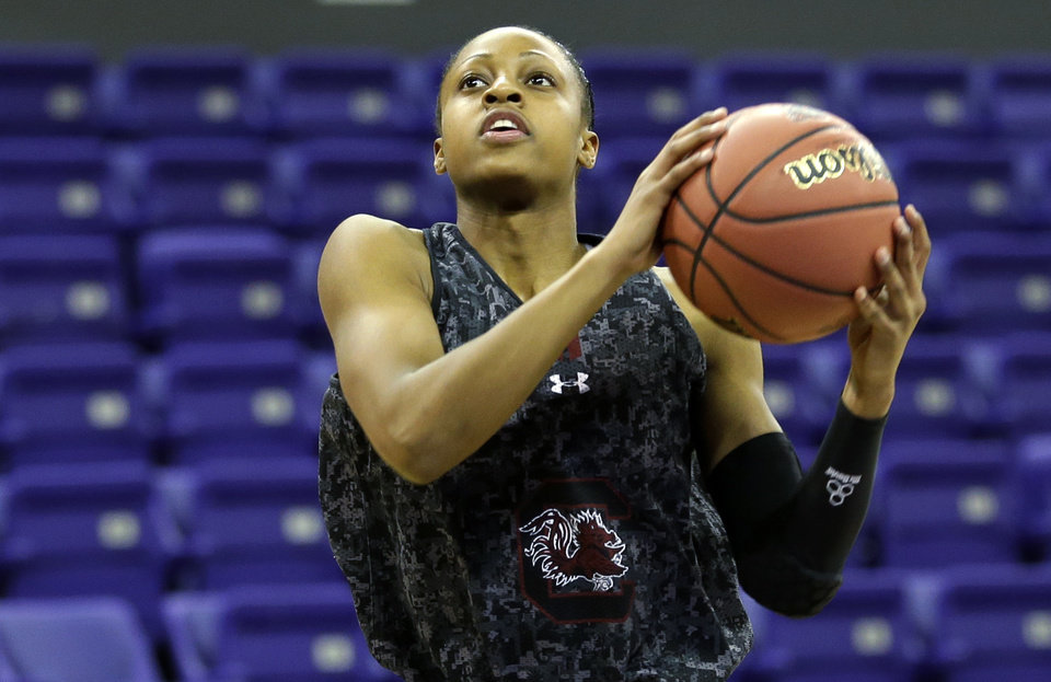 Photo - South Carolina guard Tiffany Mitchell puts up a shot during practice at the NCAA women's college basketball tournament, Saturday, March 22, 2014, in Seattle. South Carolina is scheduled to play Cal State Northridge in a first-round game on Sunday. (AP Photo/Ted S. Warren)