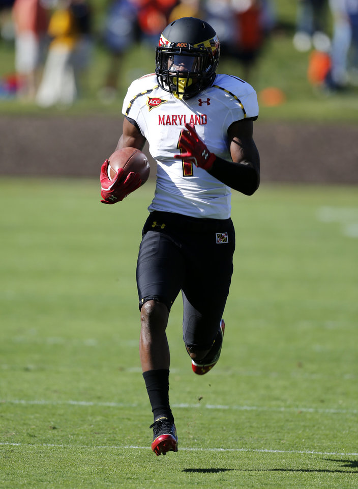 Photo -   Maryland's Stefon Diggs scores on a 100-yard return of the opening kickoff in an NCAA college football game against Virginia in Charlottesville, Va., on Saturday, Oct. 13, 2012. Maryland won 27-20. (AP Photo/Richmond Times-Dispatch, Dean Hoffmeyer)